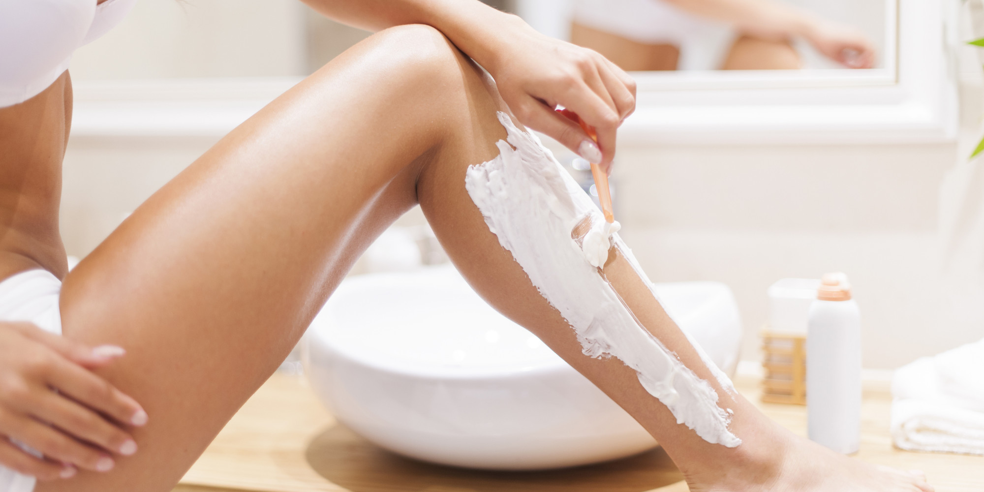 woman-shaving-her-legs
